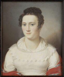 Porträt einer dame in eienr weißen Spitzenbluse und aufgestecktem Haar