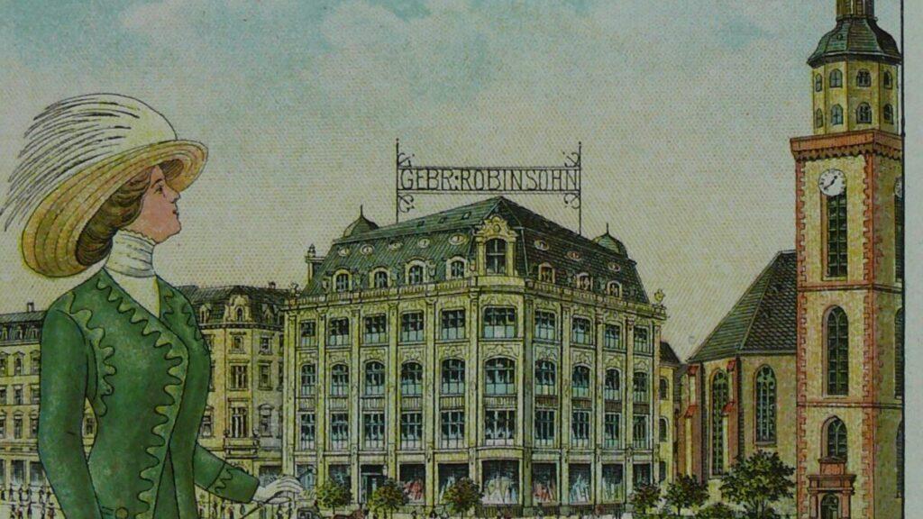 Postkarte von früher: Frau mit grünem Mantel und mit Hut steht auf der Zeil; in der Luft fährt ein zeppelin